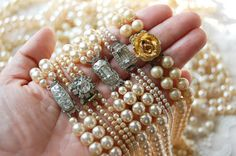 Beautiful clasps on pearl necklaces...<3