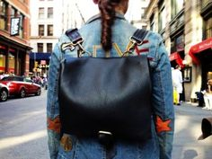 Black leather backpack thick pebbled grain leather-cross body bag