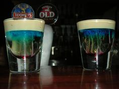 JELLYFISH SHOTS!! 1/2 shot white creme de cacao 1/2 shot amaretto almond liqueur Bailey's® Irish cream grenadine syrup Pour the creme de cacao and amaretto into a shot glass. Float enough bailey's on top to cover the shot, and then drop a few drops of grenadine into it. It looks just like a jellyfish!