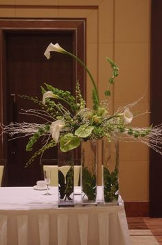 large centerpieces with callas and sticks - Google Search