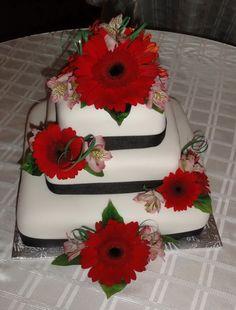 Red gerber daisies wedding cake
