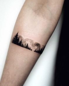 arm tattoo forest Más