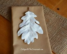 Faux White Porcelain Leaves. So simple & elegant for Fall decorating or a Thanksgiving table setting. DIY instructions on how to make them using plaster of paris from Cottage at the Crossroads.