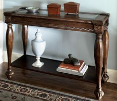 With a rich rustic brown finish this elegant entryway table is scaled narrow and tall to fit in the hall or foyer or even behind your sofa.