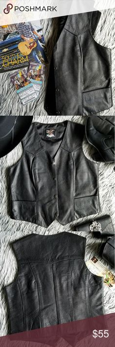 """🆕 Basic Leather Vest NWOT Whether you're ropin' and ridin' or two-steppin', this leather vest is the perfect piece to add to your wardrobe. Features four snaps upfront, two front pockets, three interior pockets, and a soft nylon lining. Long body. Made of top grain leather. Brand new. Measures 20"""" from top to hem, 19"""" from armpit to pit, 14"""" shoulder width. Size L. No trades. Jamin' Leather Jackets & Coats Vests"""