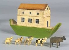 Painted Toy Noah's Ark with Animals, probably Germany, 19th century, the boat painted green, creamy yellow, and ochre, with lift off cover, containing several carved and painted pairs of animals