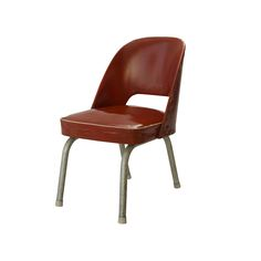 ERSA Chair______ This red leather armchair without armrests was designed by Metin Atabey Ata in the 1950s. The chair`s legs, due to lack of materials in the day, with a creative solution, were produced of water pipes. Today it is preserved at the ERSA firm.