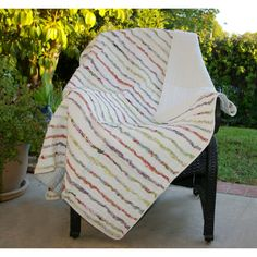 Rows of soft cotton ruffles in lively floral prints carefully pieced and quilted in pre-washed 100-percent cotton create a romantic look in this ruffled throw. The throw reverses to a matching solid color for sophistication and refined, relaxed living.
