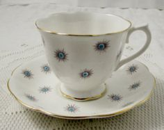 Royal Albert Tea Cup and Saucer with Yellow Stripes by TheAcreage                                                                                                                                                                                 More