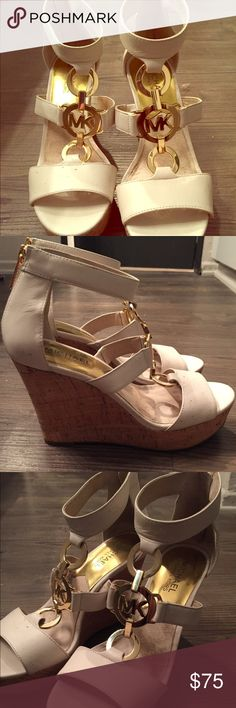 White & Gold Michael Kors Wedges Size 6.5 Michael Kors white wedges (gold hardware and cork wedge) in size 6.5, very lightly worn. I purchased these from Nordstrom originally for $120, and wore them just once to a baby shower :). Fit is true to size. Michael Kors Shoes Wedges