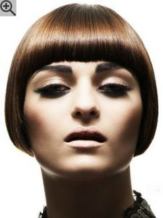 Just over the ears bob with bangs. With a warm brown color and a smooth glossy surface.