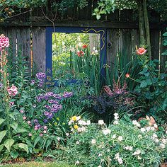 This flower bed is beautiful already, but it is transformed to straight out amazing just by hanging a mirror behind it.