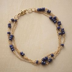 """RANDOM SAPPHIRE BRACELET -- Sapphires take random routes along three strands of 14kt gold filled chain. Lobster clasp. Exclusive. Handmade in USA. 7-1/2""""L."""
