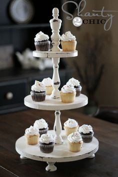 Cheap Decorating Ideas: Make a 3-tiered cupcake tower out of a couple of 1 X 2's and some wooden candlesticks for less than fifteen dollars.