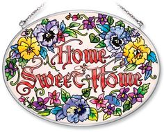 Amia Hand Painted Glass Suncatcher with Home Sweet Home Pansy Floral Design, 5-1/4-Inch by 7-Inch Oval by Amia. $19.00. Includes chain. Comes boxed, makes for a great gift. Handpainted glass. Amia glass is a top selling line of handpainted glass decor. Known for tying in rich colors and excellent designs, Amia has a full line of handpainted glass pieces to satisfy your decor needs. Items in the line range from suncatchers, window decor panels, vases, votives and much more.