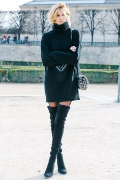 Model street style: Turtle neck oversize sweater dress with over the knee boots