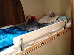 """Keep your kids in their beds with an Ikea """"Vikare"""" clamp-on bed guard rail. You may need to install an edge to clamp to."""