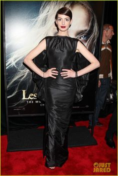 Anne Hathaway in a Tom Ford dress, Tom Ford boots and Fred Leighton jewels.