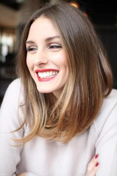 This woman (Olivia Palermo) has medium high contrast coloring. Her coloring is somewhat warm and has medium high brightness. This lipstick is too strong and too cool for her.