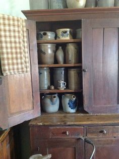 Dec. stoneware in old step back cupboard .