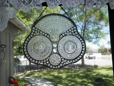 Fan plate sun catcher panel. This panel is made using clear vintage plates as the focal pieces and lots of glass nuggets all assembled in