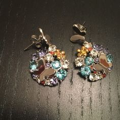 Flower butterfly earrings with Swarovski elements Brand new without box. Never worn. Very pretty, the Swarovski elements crystals are so bright and shining. Beautiful design. Jewelry Earrings