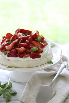 Strawberry Pavlova with Mint? Yes, please! Read the full post on Delish Dish: http://www.bhg.com/blogs/delish-dish/2013/06/17/strawberry-pavlova-with-mint/?socsrc=bhgpin061713pavlova