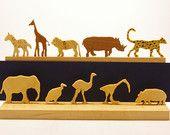 10 Miniature African Animals  - in hinged tin. Hand-cut wood elephant ibis ostrich lion hyena,giraffe vulture hippo rhino  leopard