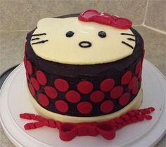 Hello Kitty cake - Dark chocolate with dark chocolate ganache and decorated with modeling chocolate.
