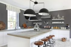 Dark grey wall, natural wood tones and white cabinetry