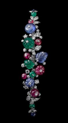 Indian Influences – High Jewelry Bracelet ~  Platinum, sapphire, ruby and emerald beads, sapphire and emerald carved leaves, brilliants.