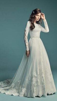 bd61459d6c3e  Ad Maggie Sottero OLYSSIA ball gown wedding dress modest elegant lace  illusion long sleeves bateau