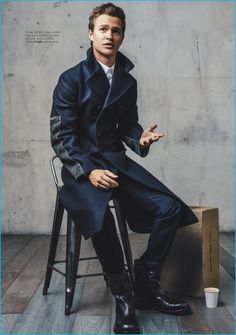 Actor Ansel Elgort dons a double-breasted coat with a smart shirt and trousers from Prada.