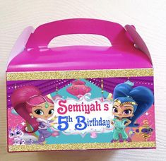 Custom shimmer and shine themed party favor boxes. These boxes come with one label attached to front of 6in x 3 1/2in party box . Font can NOT be changed on these boxes. Color of font can be changed as requested. These treat boxes have a processing time of 1-2 weeks. Please be sure to leave