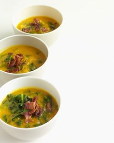 Acorn Squash Soup with Kale - Brilliant-orange acorn squash puree provides a striking background for deep-green kale in this fiber-rich soup. A garnish of crumbled bacon adds a savory dimension to the soup.