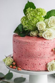 This strawberry basil cake is drizzled with a strawberry simple syrup and coated with a delicious strawberry buttercream. #strawberrybasil #cake Frostingandfettuccine.com