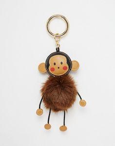 Imagen 1 de Llavero con pompón Cheeky Monkey de ASOS