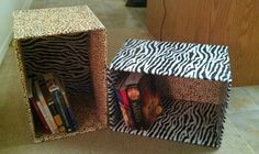 Old moving boxes covered in your choice of wrapping paper! These go with my jungle/safari themed room!