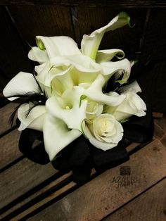 calla lilies, white roses and black feathers bridesmaid bouquet www.azaleaflowers.co.uk