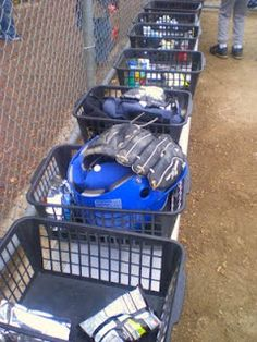 Stacking bins from the DollarTree can really help keep the player's gear, water bottles and snacks organized. I just made simple name labels for each bin and put them under the bench in their batting order. At the end of a game, I put all the baskets on top of the bench and fill them with their snacks.