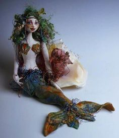 Mermaid doll by Patti Medaris CuleaI have this pattern and I am hanging to make her.