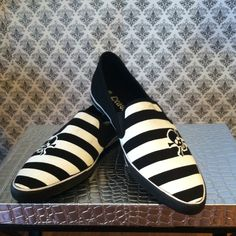 Rockabilly Skulls Over Strips Point SlipOn NWT 8.5 Features: rockabilly slight pointed toe slip on style/ skull detail over black n white / rubber outer sole / canvas material / padded inner sole From Boutique NWT Sz 8.5 Boutique Shoes