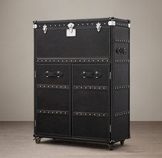 RH's Mayfair Bar Cart - Old Saddle Black:Like the stalwart trunks that accompanied travelers by sea and rail a century ago, our bar cabinet is solidly built, clad in leather and edged all around with scores of brass nailheads hammered by hand. The lower doors open to a roomy interior, lined with stainless steel and fitted with a shelf for bottles and barware. The hinged top lifts and the front panel drops down, creating a handy spot for crafting cocktails and pouring wine. A mirror beneath…