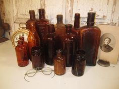 Brown bottles Brown Bottles, Antique Bottles, Bottles And Jars, Glass Bottles, Vintage Farmhouse, Farmhouse Decor, Shape And Form, Decorating Blogs, Wedding Flowers