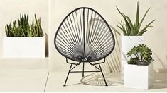 acapulco black egg outdoor chair | CB2 $280