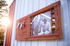 LOVE this! Old door as a picture frame with YAY bunting. Beautiful!   (Love this whole blog post of an outdoor/rustic/chic wedding rehearsal!)