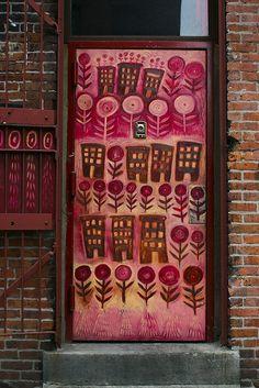 DUMBO (Down Under Manhattan Bridge) decorated door in New York