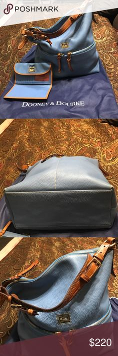 Dooney and Bourke Authentic Dooney and Bourke large handbag. Some wear in the corners. Very good condition. Dooney & Bourke Bags Shoulder Bags