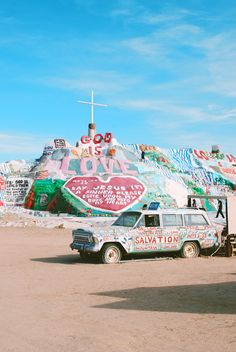 Salvation Mountain, California. Is about an hour from palm springs in the middle of the desert. you are driving along an empty road and then you see a colorful painted mountain in the distance. it feels like a dream, really. the mountain is made from adobe, straw and thousands of gallons of paint.
