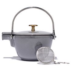 Staub may be a French classic, but there's something decidedly Japanese about the sleek silhouette and stainless steel handle of this cast iron teapot. Plus, the pretty grey-and-brass coloring is excl Cast Iron Kettle, New Year Designs, French Classic, Kitchen Pantry, Beautiful Kitchens, Kitchen Organization, Kitchenware, Beams, Tea Time